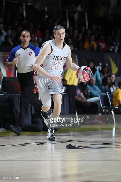 Secretary of Education Arne Dunan of the West team dribbles during the Sprint Celebrity Game at Jam Session during NBA All Star Weekend on February...