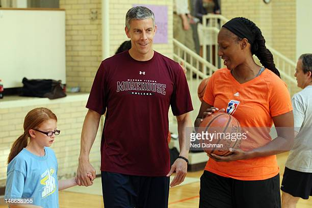 S Secretary of Education Arne Duncan and Chamique Holdsclaw exchange a laugh while playing basketball Senior Administration Officials and Members of...