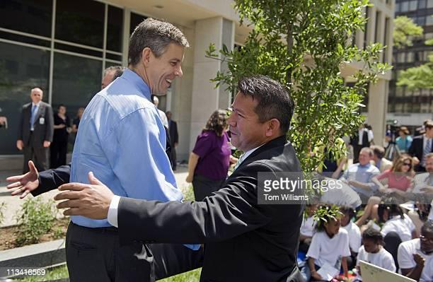 Secretary of Education Arne Duncan, left, hugs elementary school teacher Jose Rodriguez, of Cedar Park, TX, during a tree planting ceremony at the...