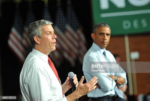 S Secretary of Education Arne Duncan speaks alongside US President Barack Obama at a town hall style meeting at North High School on September 14...