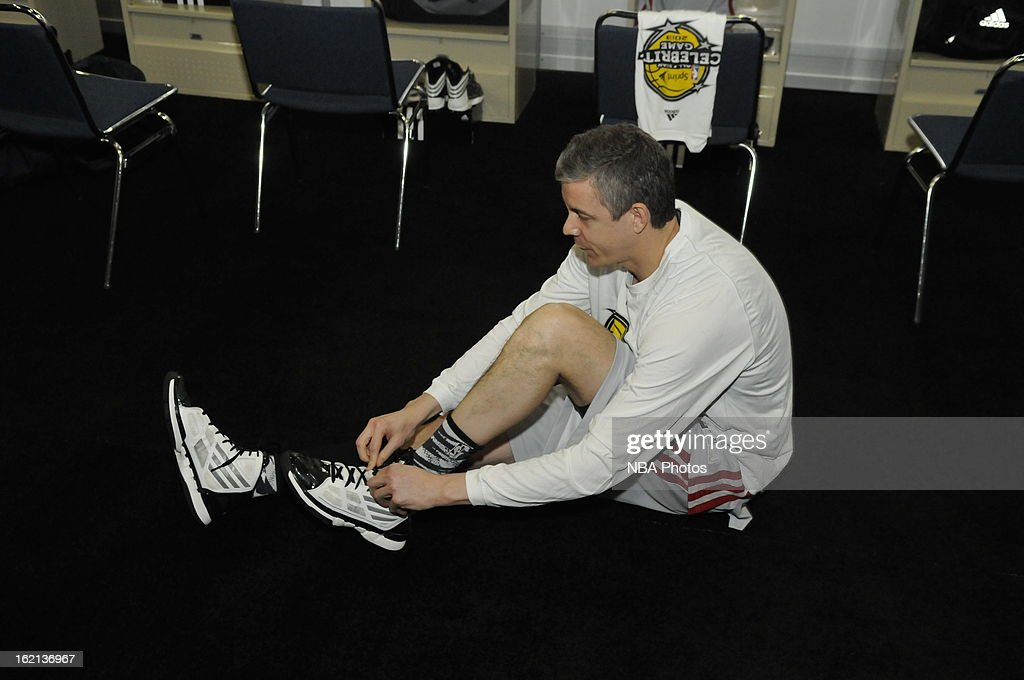 Secretary of Education Arne Duncan ties his shoes during the Sprint NBA All-Star Celebrity Game in Sprint Arena at Jam Session during the NBA All-Star Weekend on February 15, 2013 at the George R. Brown Convention Center in Houston, Texas.
