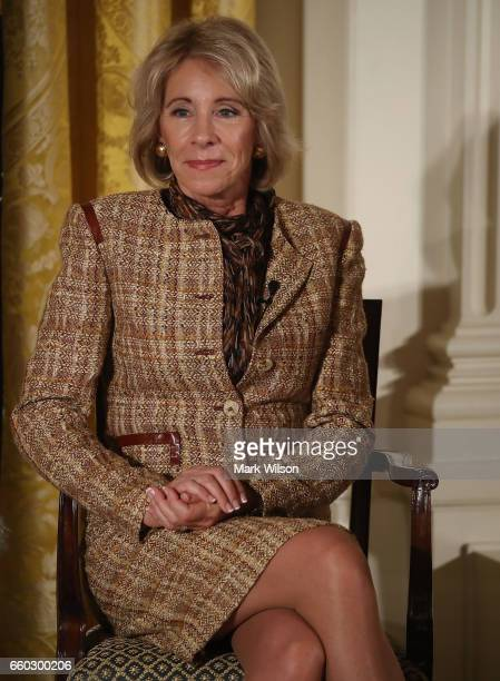 Secretary of Education Betsy DeVos attends an event celebrating Women's History Month in the East Room at the White House March 29 2017 in Washington...