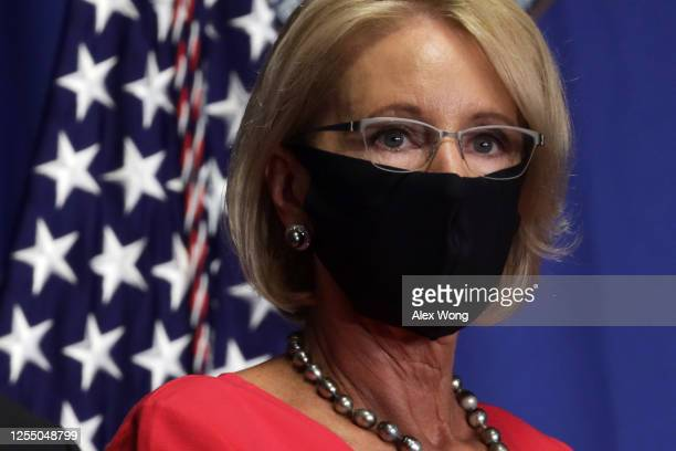 S Secretary of Education Betsy DeVos listens during a White House Coronavirus Task Force press briefing at the US Department of Education July 8 2020...