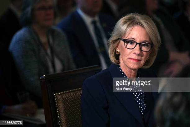 S Secretary of Education Betsy DeVos listens during an Interagency Working Group on Youth Programs meeting at the State Dining Room of the White...