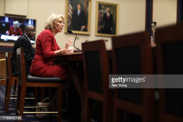 Secretary of Education Betsy DeVos speaks as Chief Operating Officer of Federal Student Aid Mark Brown listens during a hearing before House...