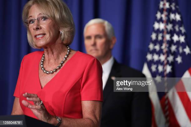 Secretary of Education Betsy DeVos speaks as Vice President Mike Pence listens during a White House Coronavirus Task Force press briefing at the U.S....
