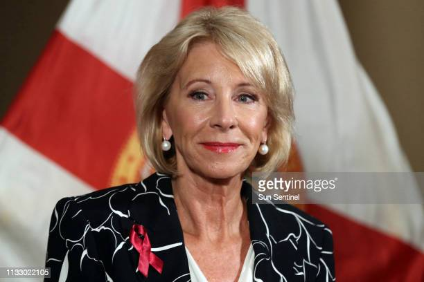 US Secretary of Education Betsy Devos speaks during a news conference at the Marriot Heron Bay in Coral Springs Fla in 2018 DeVos defended deep cuts...