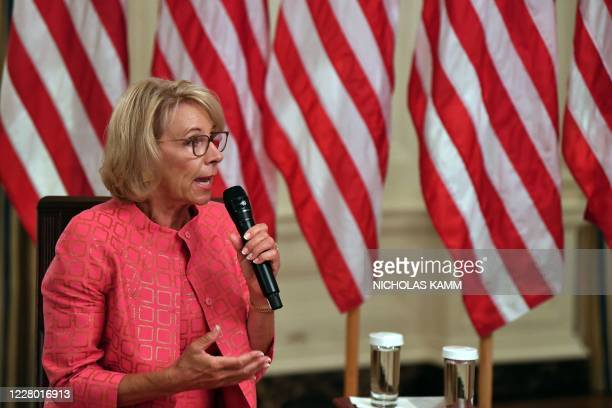 """Secretary of Education Betsy DeVos speaks during the """"Getting America's Children Safely Back to School"""" event in the State Room of the white House in..."""