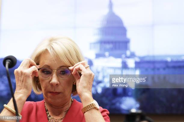 Secretary of Education Betsy DeVos waits for the beginning of a hearing before House Education and Labor Committee December 12, 2019 on Capitol Hill...