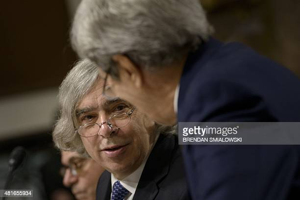 US Secretary of Energy Ernest Moniz and US Secretary of State John Kerry talk during a hearing of the Senate Foreign Relations Committee on Capitol...