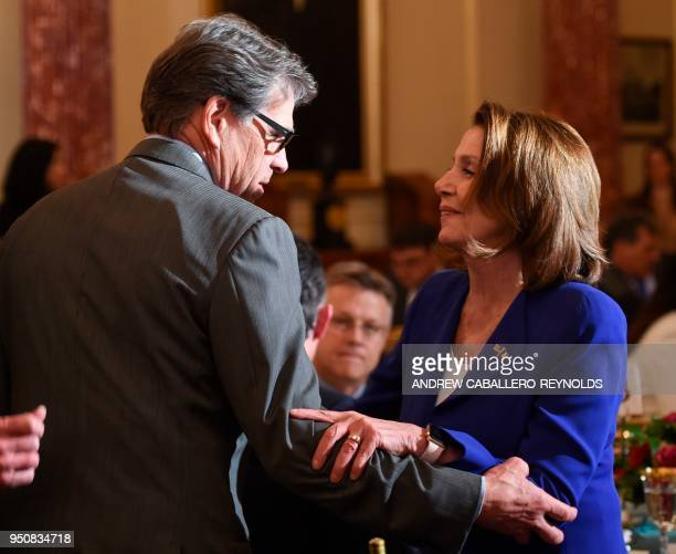 US Secretary of Energy Rick Perry greets House Minority leader Nancy Pelosi before a luncheon with French President Emmanuel Macron and US Vice...