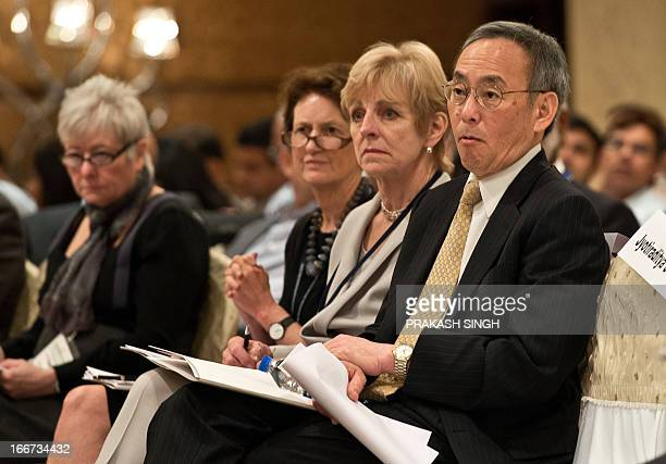 US Secretary of Energy Steven Chu and his wife Jean H Chu who is advisor emerita of Stanford University listen to a speaker during a panel event on...