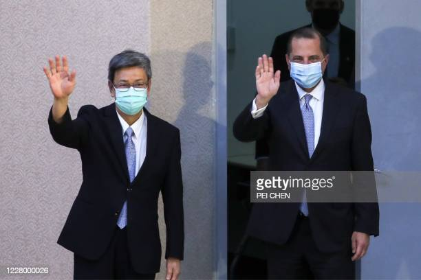 Secretary of Health and Human Services Alex Azar and former Taiwanese Vice President Chen Chien-jen wave as they attend a speech at the public health...