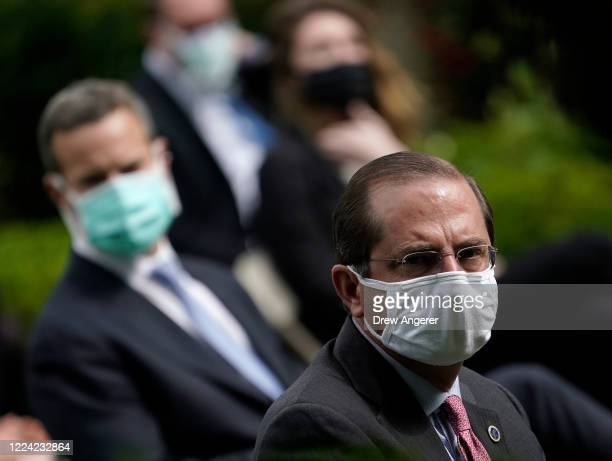 Secretary of Health and Human Services, Alex Azar and others wear face masks while attending a press briefing about coronavirus testing in the Rose...