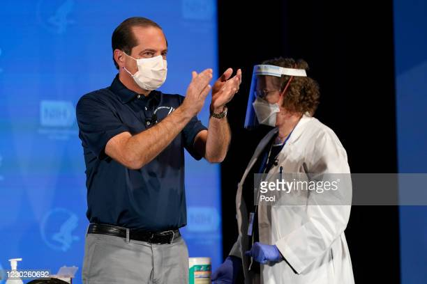Secretary of Health and Human Services Alex Azar applauds after receiving his first dose of the COVID-19 vaccine at the National Institutes of Health...