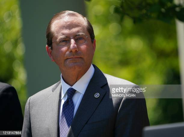 Secretary of Health and Human Services Alex Azar listens during a vaccine development announcement on May 15 in the Rose Garden of the White House in...