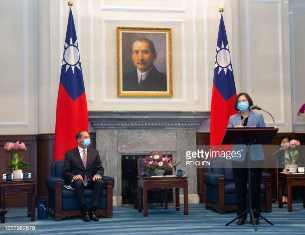 Secretary of Health and Human Services Alex Azar looks on as Taiwan's President Tsai Ing-wen speaks during his visit to the Presidential Office in...