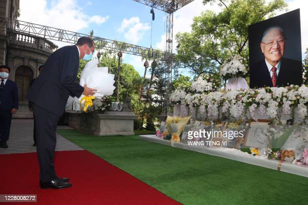 Secretary of Health and Human Services Alex Azar offers a wreath as he pays his respects to late Taiwanese president Lee Teng-hui at the Taipei Guest...