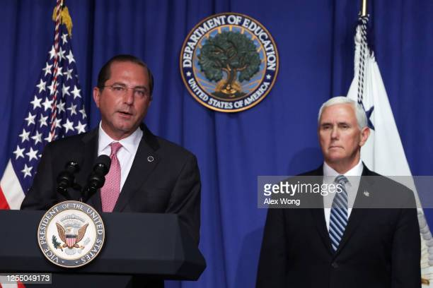 Secretary of Health and Human Services Alex Azar speaks as Vice President Mike Pence listens during a White House Coronavirus Task Force press...