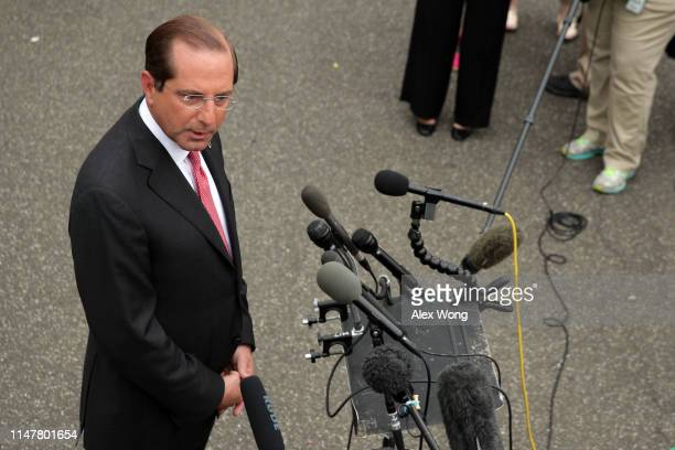 S Secretary of Health and Human Services Alex Azar speaks to members of the media outside the West Wing of the White House May 8 2019 in Washington...