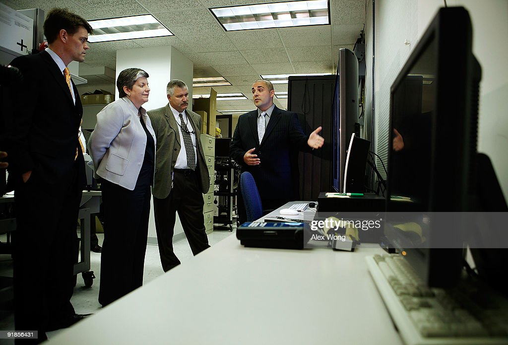 U.S. Secretary of Homeland Security Janet Napolitano (2nd L) listens to Section Chief for Computer Forensic Christopher Landi's (R) introduction during her visit to the Cyber Crimes Center of the U.S. Immigration and Customs Enforcement October 13, 2009 in Fairfax, Virginia. The Cyber Crime Center, which is formed with the Child Exploitation Section, the Computer Forensics Section and the Cyber Crimes Section, focus on investigating criminal activities occur on or facilitated by the Internet. It also offers training to local, federal, and international law enforcement agencies. Assistant Homeland Security Secretary for Immigration and Customs Enforcement John Morton is on the left and computer forensic agent Douglas Skinner is on third left.