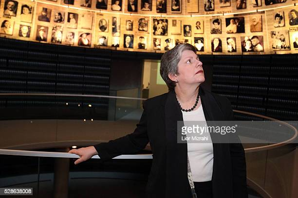US Secretary of Homeland Security Janet Napolitano looks at pictures of Jewish Holocaust victims at the Hall of Names during her visit to the Yad...