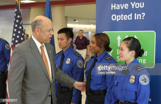 Secretary of Homeland Security Jeh Johnson greets TSA agents after addressing a press conference at Los Angeles International Airport on February 20...