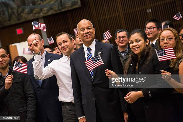 Secretary of Homeland Security Jeh Johnson takes a photo with new US citizens after their naturalization ceremony at the United States District Court...