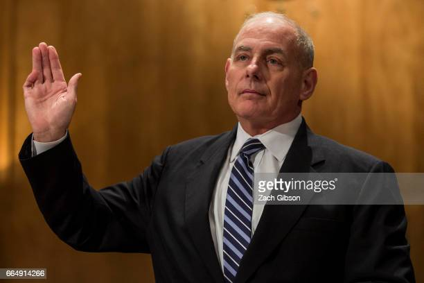 Secretary of Homeland Security John Kelly is sworn in before testifying during a Senate Homeland Security Committee hearing on April 5 2017 on...