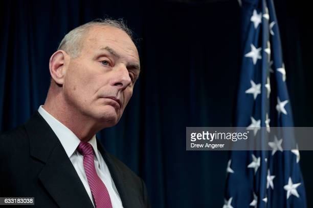 Secretary of Homeland Security John Kelly listens to questions during a press conference related to President Donald Trump's recent executive order...