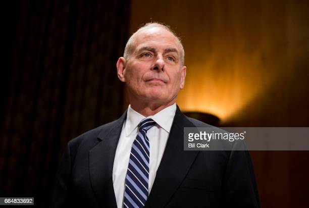 Secretary of Homeland Security John Kelly prepares to testify during the Senate Homeland Security and Governmental Affairs Committee hearing on...