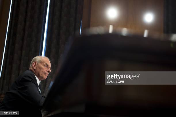 US Secretary of Homeland Security John Kelly testifies during a Senate Homeland Security and Governmental Affairs Committee hearing on Capitol Hill...