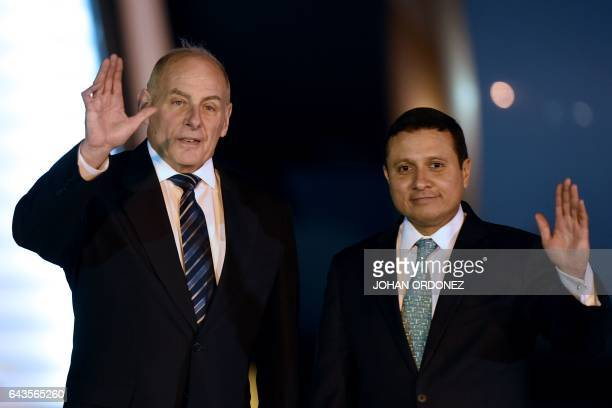 US Secretary of Homeland Security John Kelly waves next to Guatemalan Foreign Minister Carlos Morales upon his arrival at the Guatemalan Air Force...