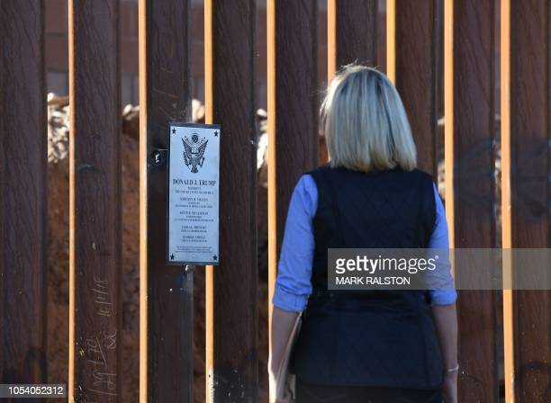 US Secretary of Homeland Security Kirstjen M Nielsen looks at the plaque bearing President Trump's name on a newly renovated completed section of the...