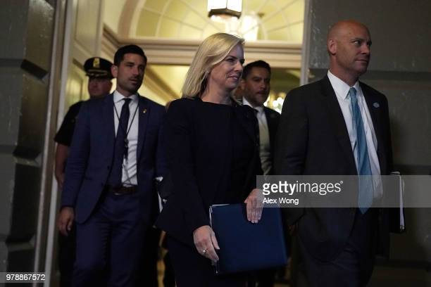 S Secretary of Homeland Security Kirstjen Nielsen and White House Director of Legislative Affairs Marc Short arrive at a meeting between US President...