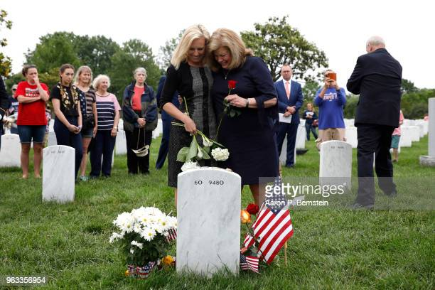 Secretary of Homeland Security Kirstjen Nielsen embraces Karen Kelly wife of White House Chief of Staff John Kelly as they pay their respects to...