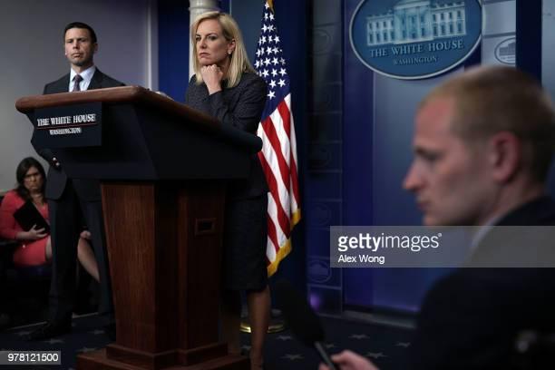 S Secretary of Homeland Security Kirstjen Nielsen leaves after she briefed members of the press as White House Press Secretary Sarah Sanders looks on...