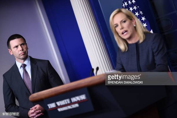 US Secretary of Homeland Security Kirstjen Nielsen speaks as Kevin K McAleenan Commissioner of US Customs and Border Protection looks on at a press...