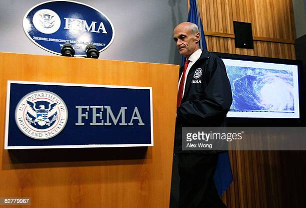 S Secretary of Homeland Security Michael Chertoff arrives for a news conference at the headquarters of FEMA September 11 2008 in Washington DC...