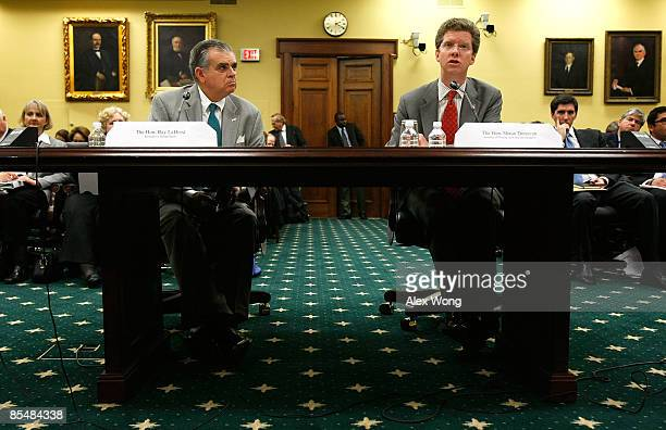 S Secretary of Housing and Urban Development Shaun Donovan speaks as Secretary of Transportation Ray LaHood listens during a hearing before the...