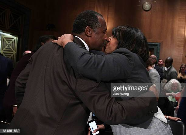 Secretary of Housing and Urban Developmentdesignate Ben Carson receives a kiss from his wife Candy Carson after his confirmation hearing before...