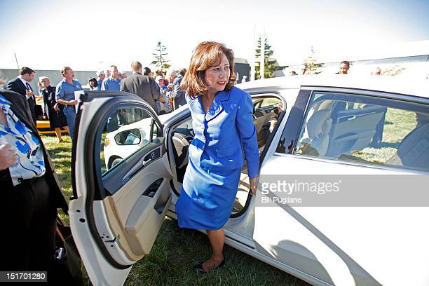 S Secretary of Labor Hilda Solis exits from a 2013 Ford Fusion while attending an event that celebrates the opening of the new US production line...