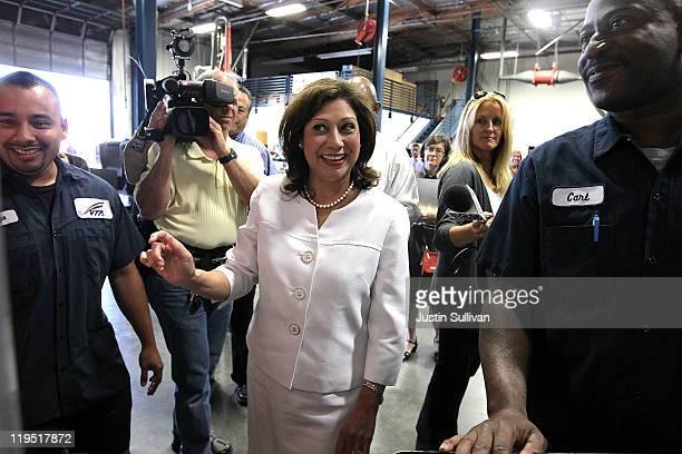 S Secretary of Labor Hilda Solis jokes with students in the Santa Clara Valley Transportation Authority hybrid technology training program on July 21...