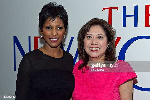S Secretary of Labor Hilda Solis poses for a photo with a guest at the New Yorker White House Correspondents' dinner preparty at The W Hotel rooftop...
