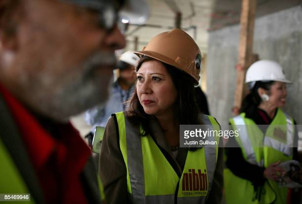 S Secretary of Labor Hilda Solis wears a hard hat as she tours a construction site March 17 2009 in San Francisco California Secretary Solis was in...