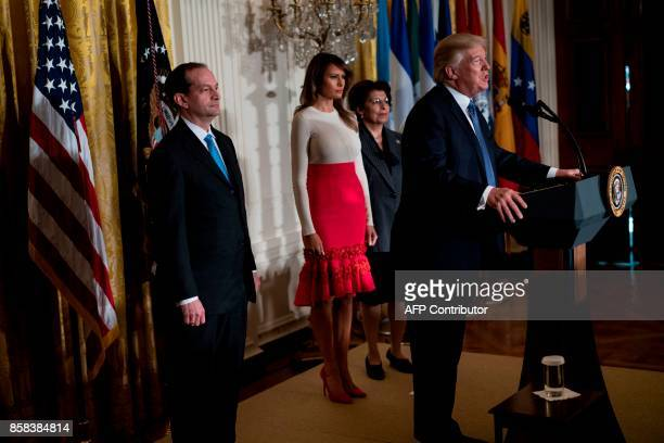 US Secretary of Labor R Alexander Acosta US First Lady Melania Trump and Jovita Carranza Treasurer of the United States listen while US President...