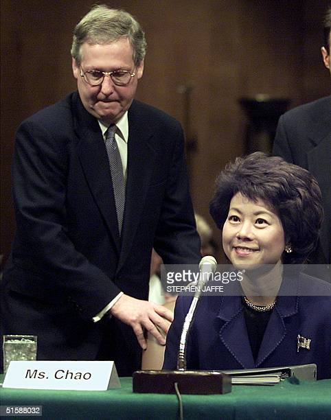 Secretary of Labor-designate Elaine Chao is escorted by her husband, US Senator Mitch McConnell, R-KY, as she enters the Health, Education, Labor and...