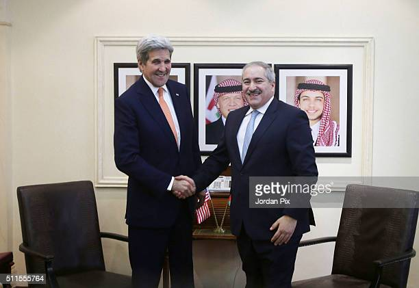S Secretary of Sate John Kerry shakes hands with Jordanian Foreign Minister Nasser Judeh on February 21 2016 in Amman Jordan While in Ammnan Kerry...