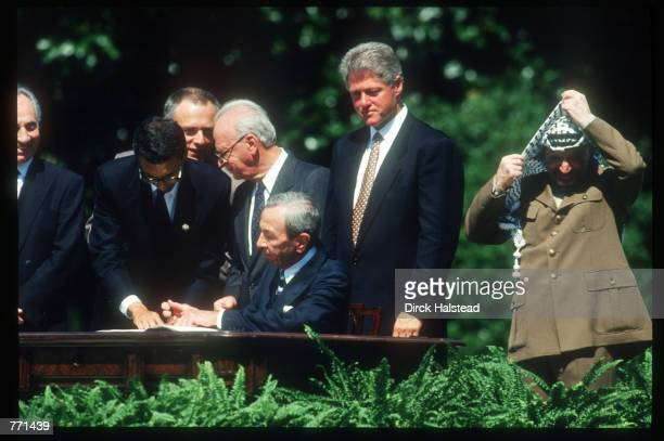 Secretary of Sate Warren Christopher signs the Mideast Peace Accord between Israel and the PLO September 13, 1993 in Washington, DC. The peace accord...