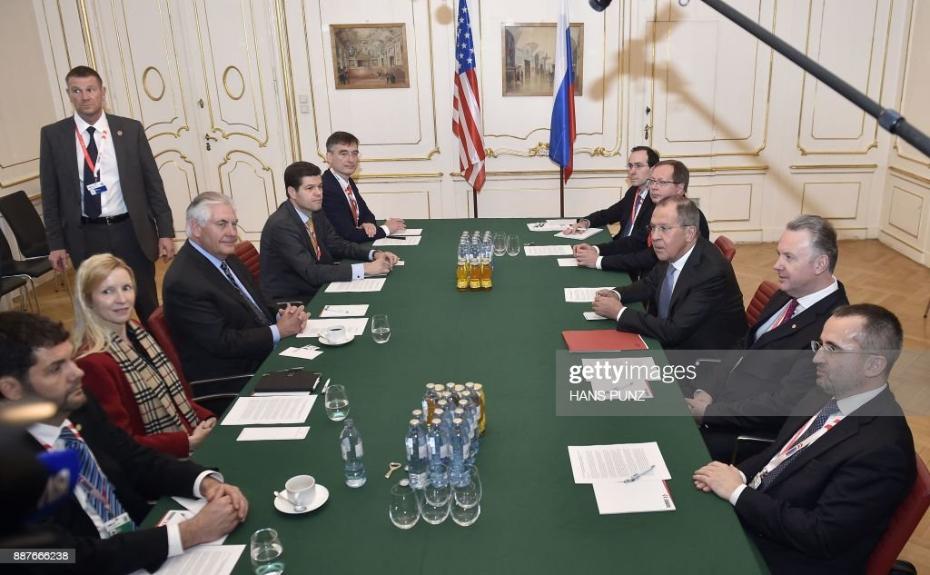 US Secretary of Stae Rex Tillerson (3rdL) and Russian foreign minister Sergei Lavrov (3rdR) hold bilateral talks during the 24th OSCE Ministerial Council in Vienna, on December 07, 2017. ?Foreign ministers of the OSCE's 57 member states including US Secretary of State Rex Tillerson and Russian counterpart Sergei Lavrov hold the annual conference, during which the conflict in Ukraine will likely be a major topic. / AFP PHOTO / APA / HANS PUNZ / Austria OUT